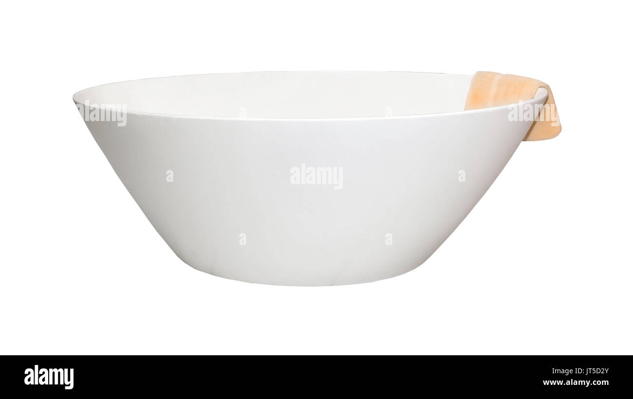 Modern oval bathtub with towel hanging from the edge - Stock Image