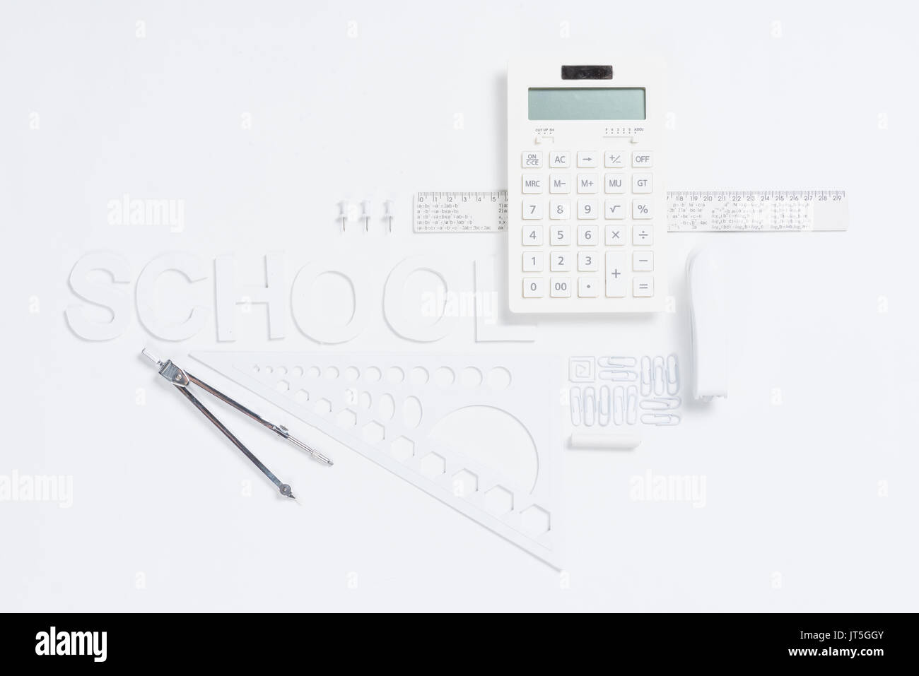 calculator with rulers and stapler with compasses mock-up isolated on white - Stock Image