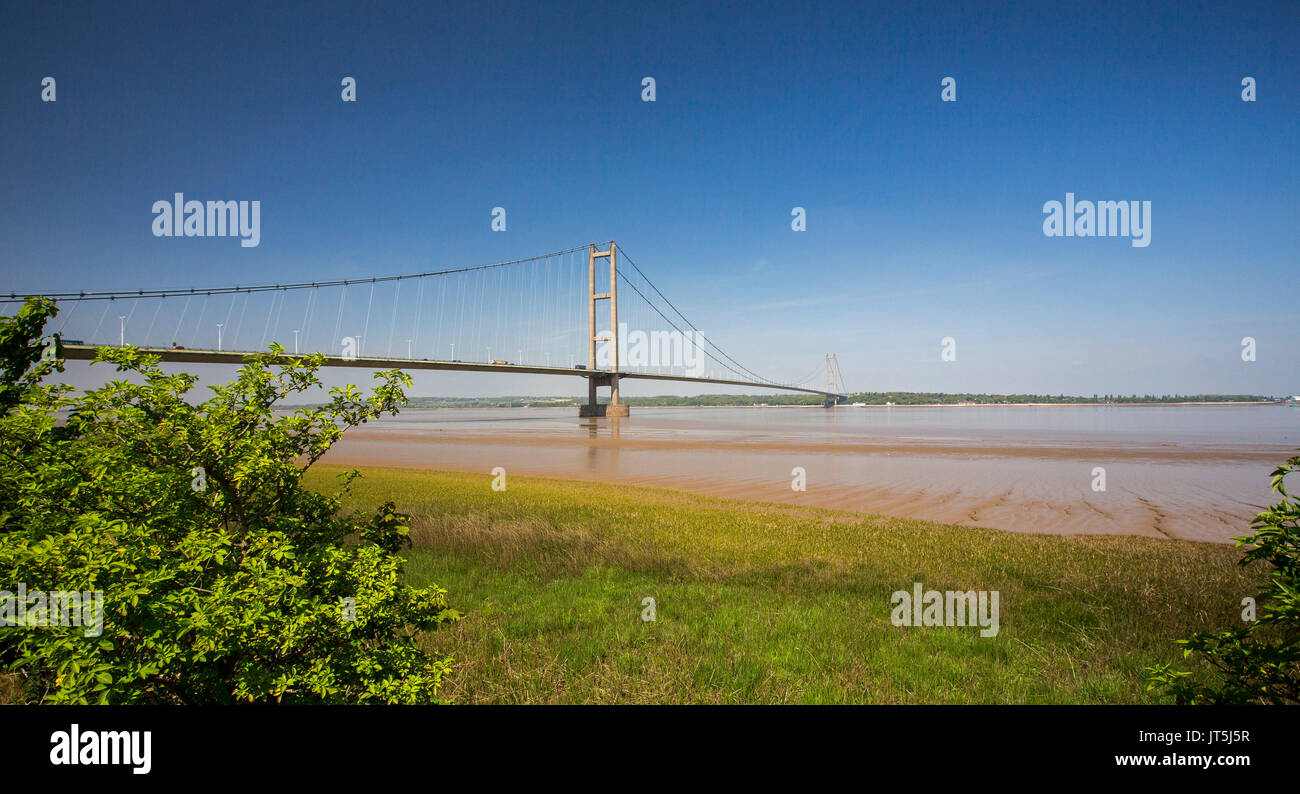 Panoramic view of long suspension bridge over Humber River under blue sky near Kingston Upon Hull, England Stock Photo