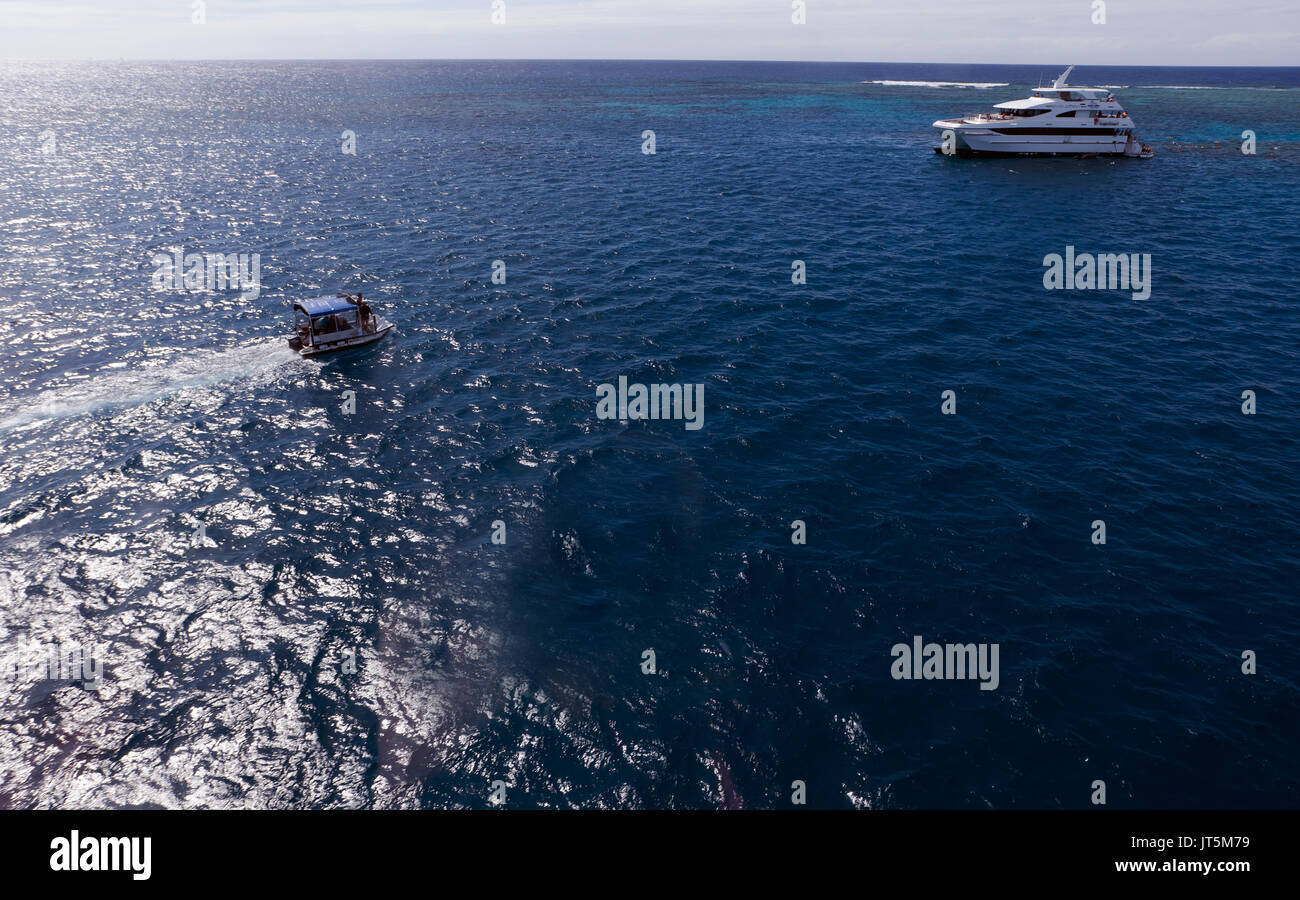 Aerial view of the Evolution Catamaran and shuttle boat, operated by the Down Under Cruise and Dive Company, Cairns, Australia - Stock Image