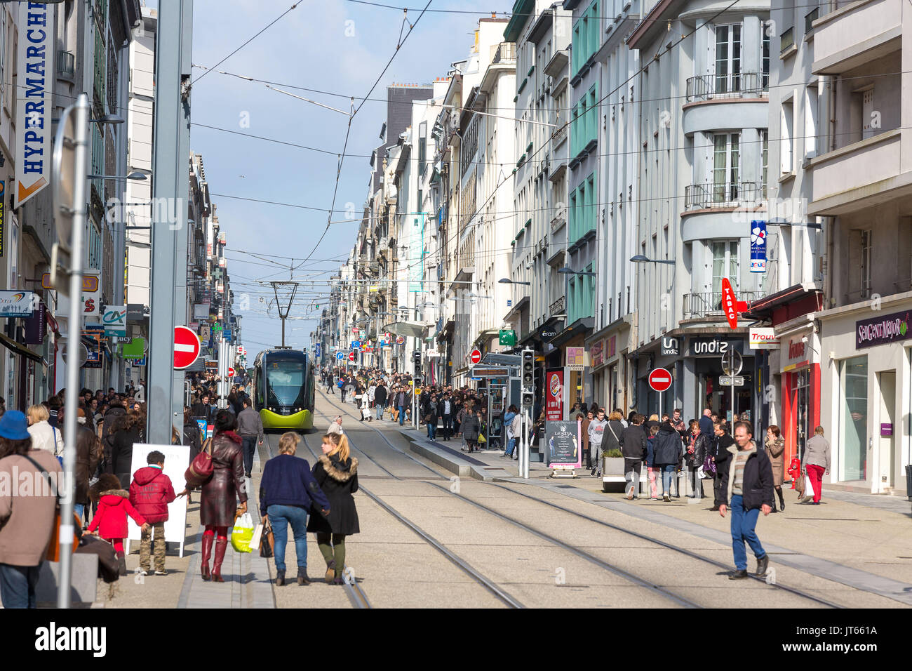 Brest (Brittany, north-western France): tram and pedestrians in the street 'rue Jean Jaures', in downtown Brest. Passers-by, tram and buildings along  - Stock Image