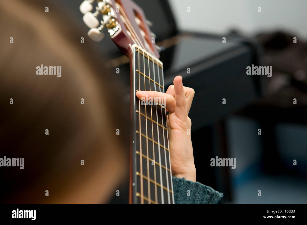 Young Girl Teenager Learning How To Play The Guitar Hand Playing