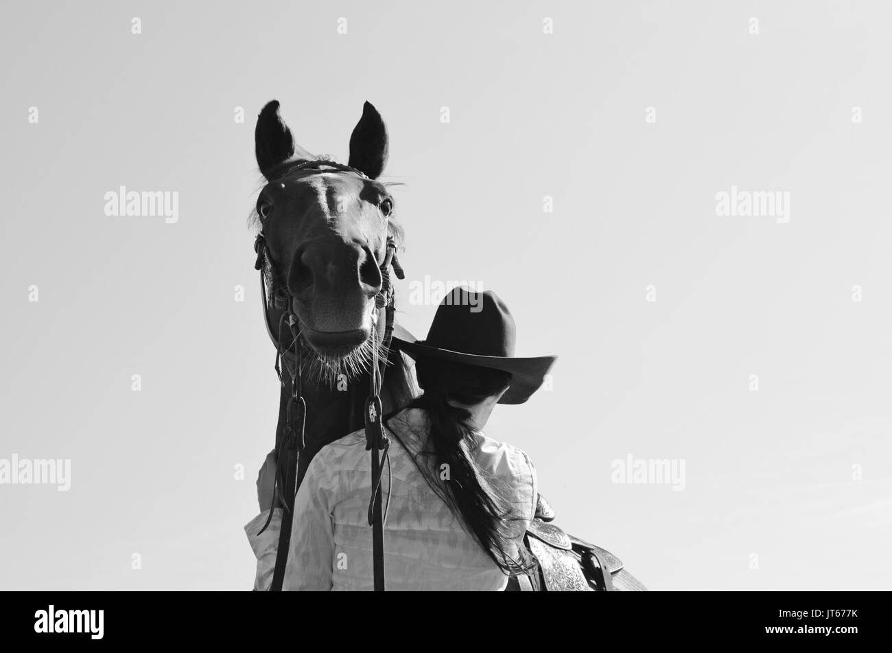 Country girl in cowboy hat with cute horse looking over her shoulder dfd8f93714aa