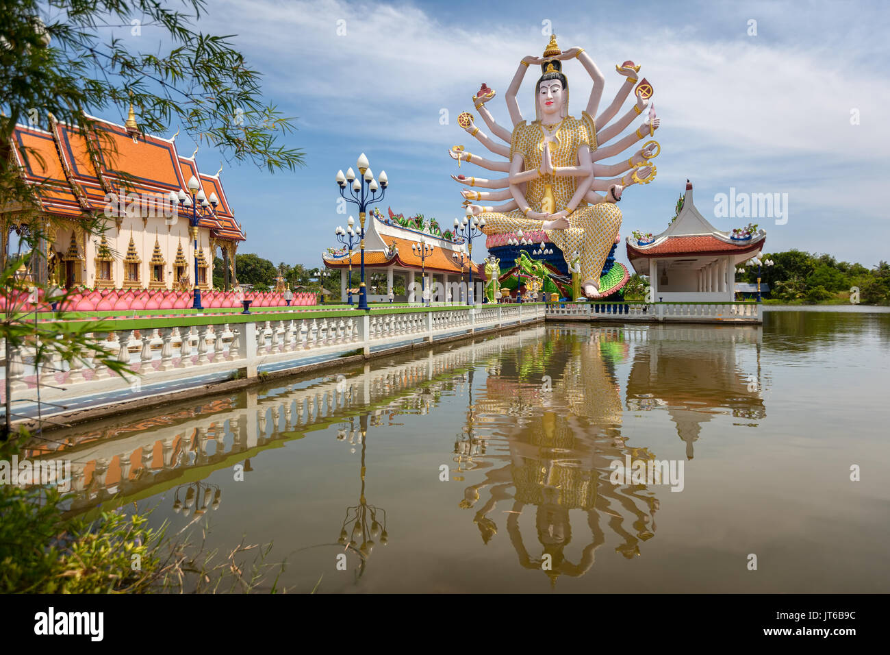 Statue of eighteen arms of Guanyin Avalokiteśvara or Guanjin Kwan Yin, Goddess of Mercy and Compassion, Wat Plai Stock Photo