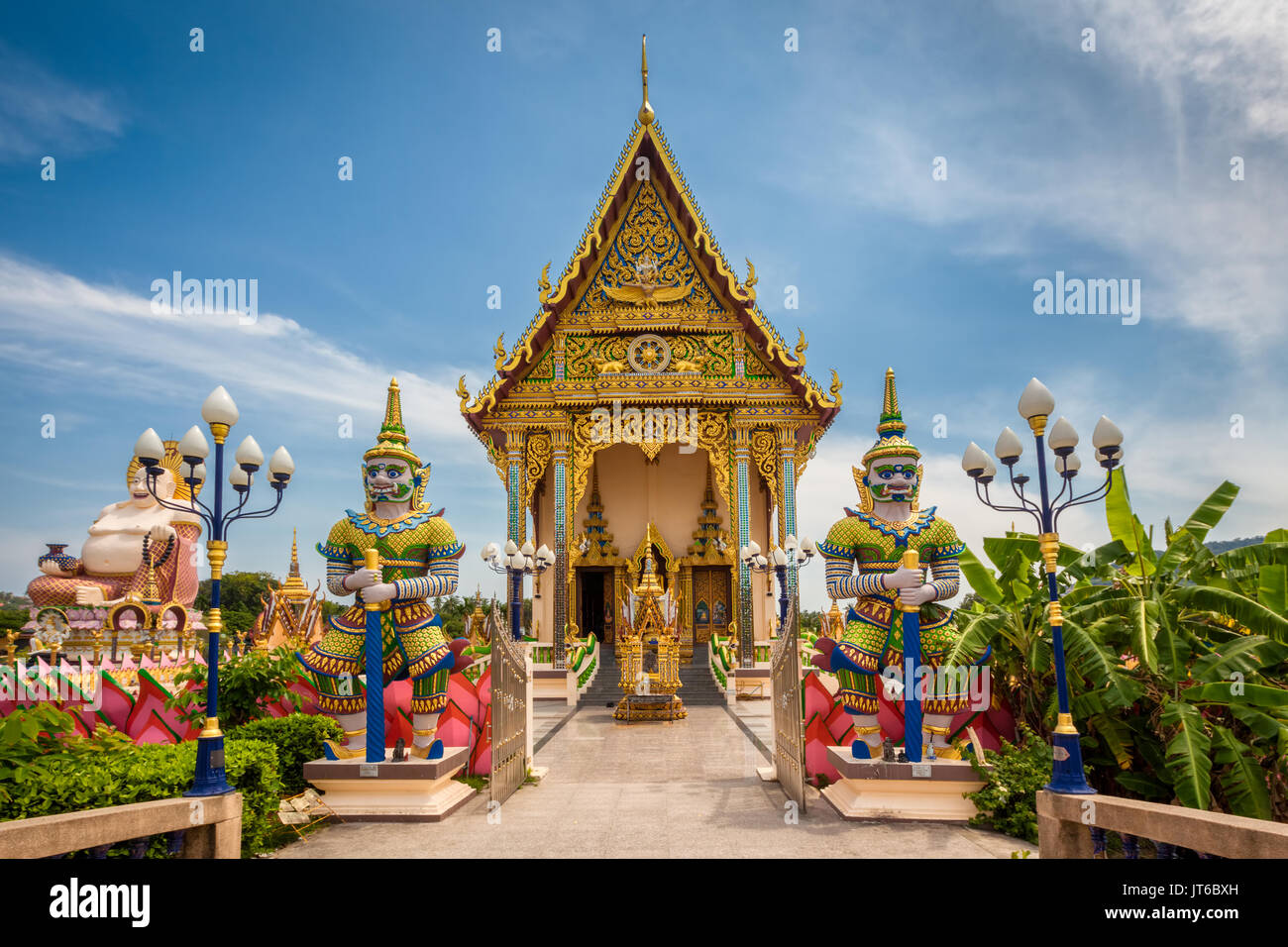 Giant guardians at entrance of the Buddhist Pagoda, Wat Plai Laem Temple, Suwannaram Ban Bo Phut, Koh Samui, Thailand - Stock Image