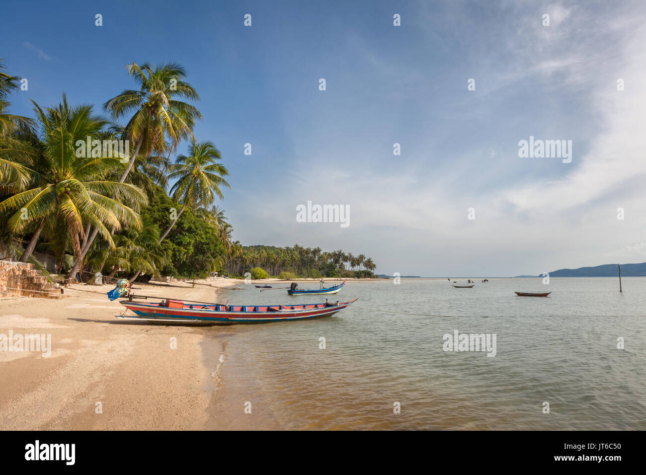 Thai fishing boats moored at Thong Krut beach, Koh Samui island, Thailand - Stock Image