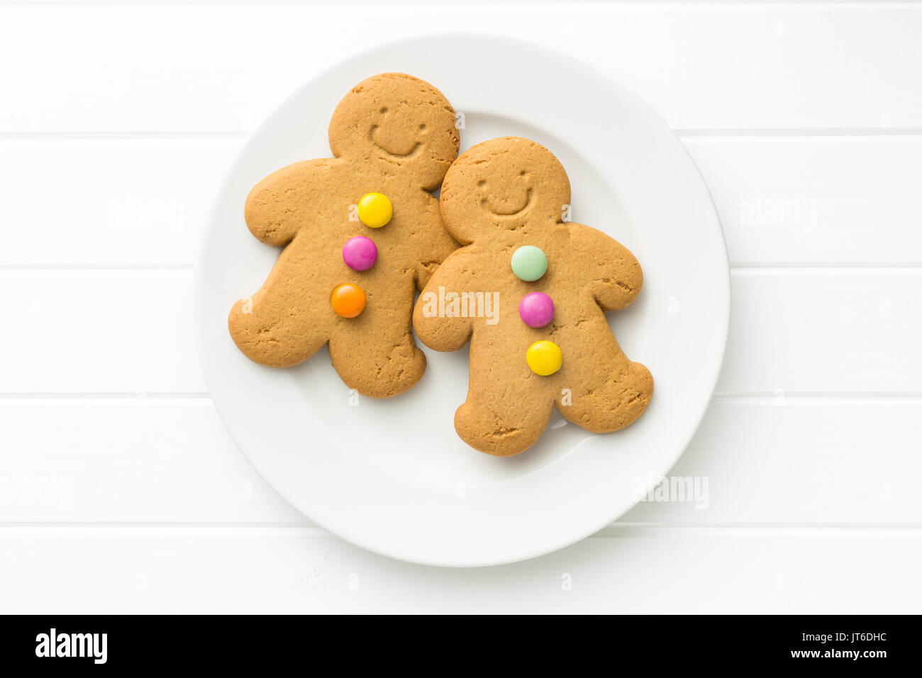 Two gingerbread men. Xmas gingerbread on white table. Top view. - Stock Image