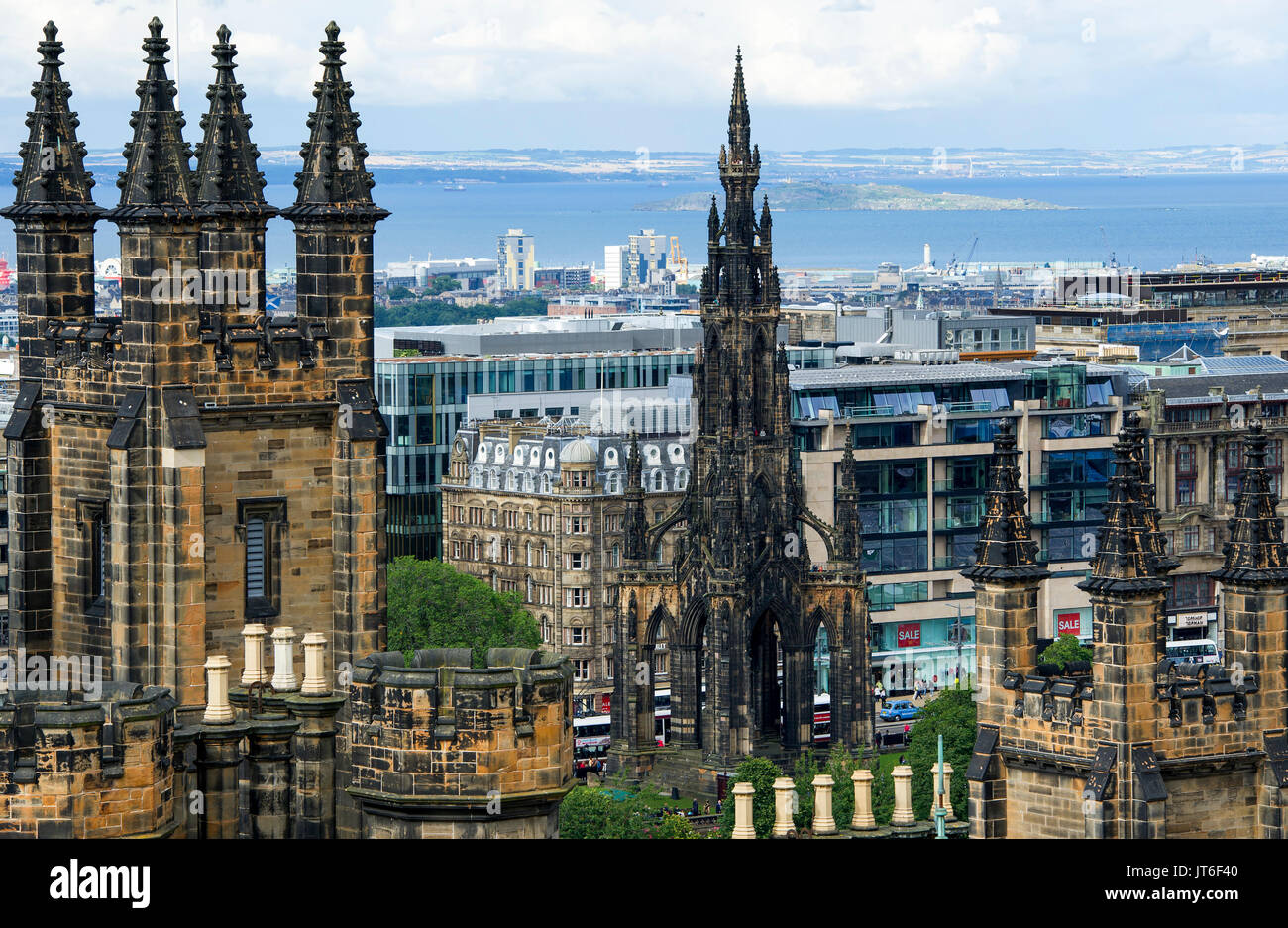 Assembly halls spires in the left foreground and the top of the Scott Monument (centre) Edinburgh. Stock Photo