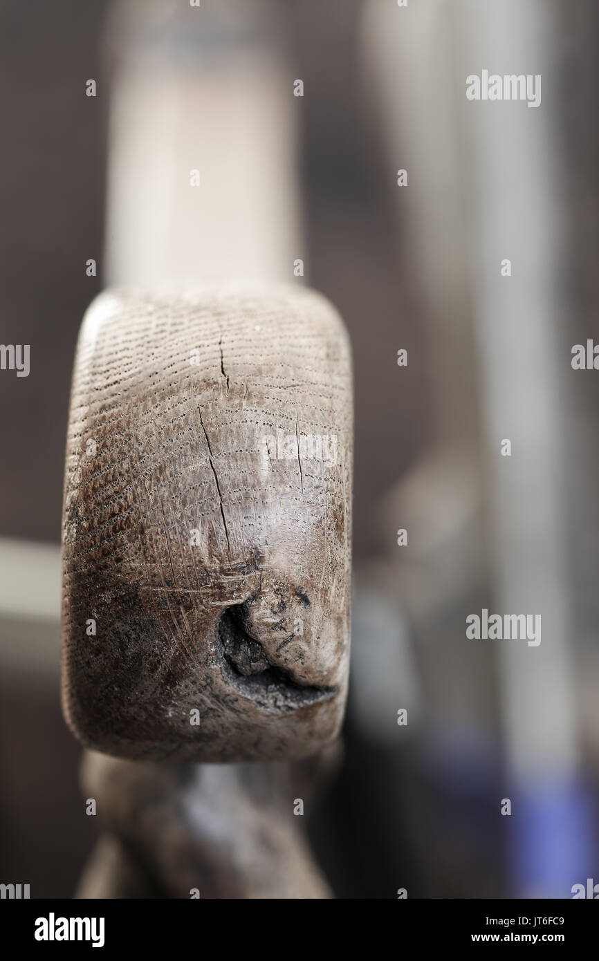 Traditional jacobean style antique arm chair handle with wood knot hole old dusty weathered oak Stock Photo