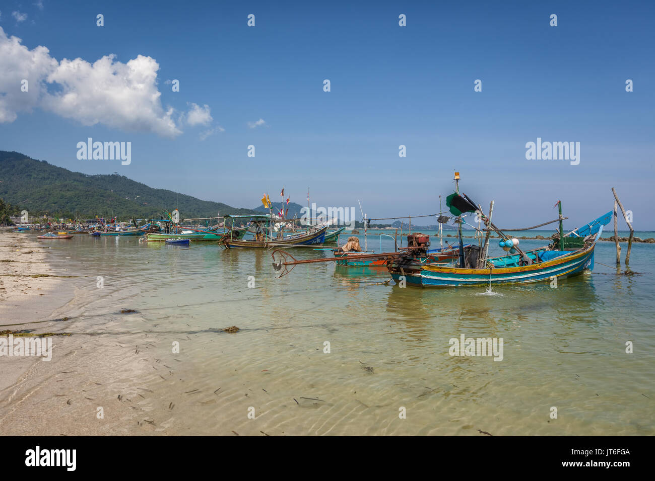 Thai fishing boats mooored at Hua Thanon beach, Koh Samui Island, Thailand - Stock Image