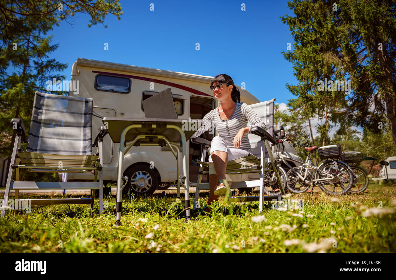 Woman Looking At The Laptop Near Camping Caravan Car Vacation Family Travel Holiday Trip In Motorhome Wi Fi Connection Information C