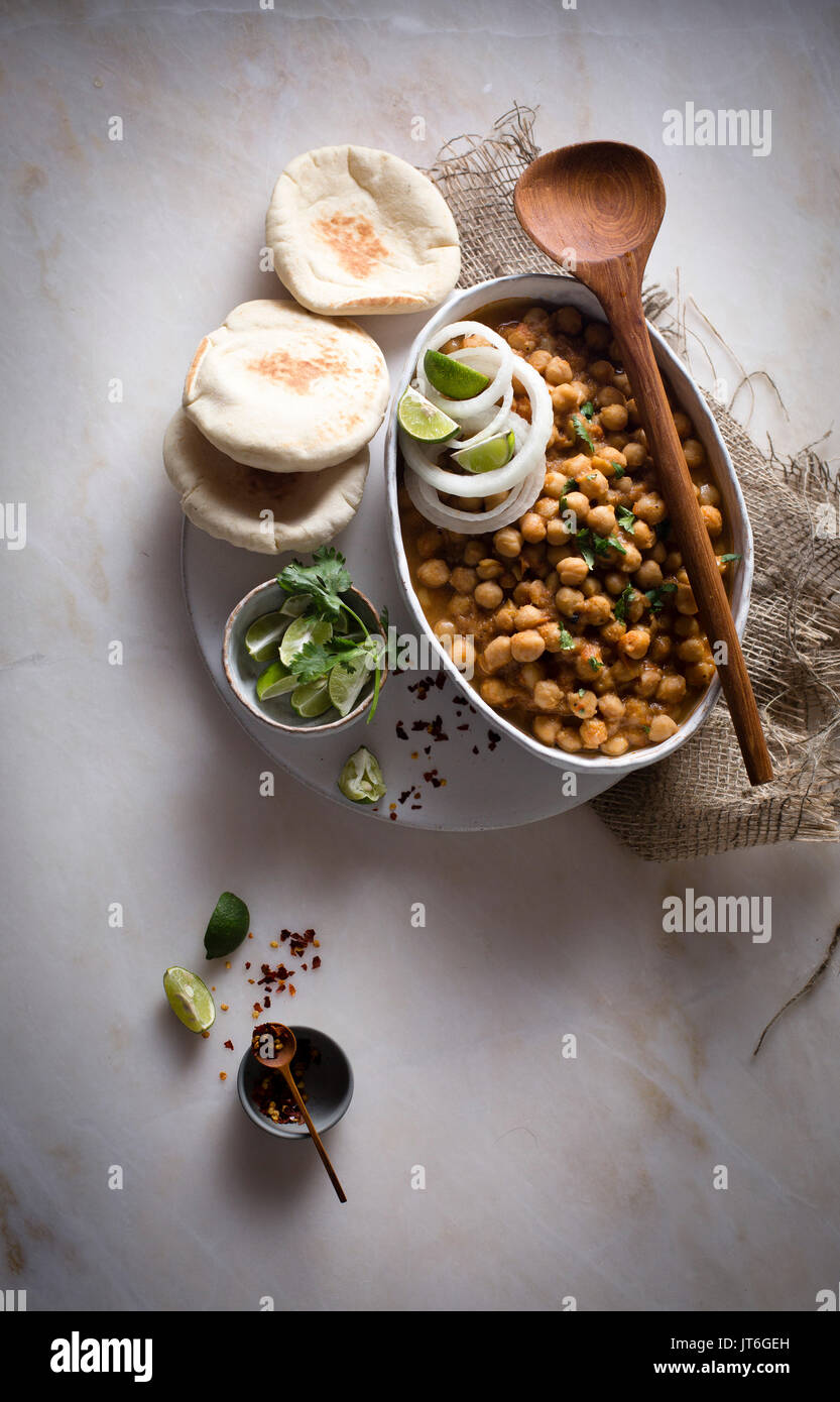 Curried chickpeas with pita bread on top view - Stock Image