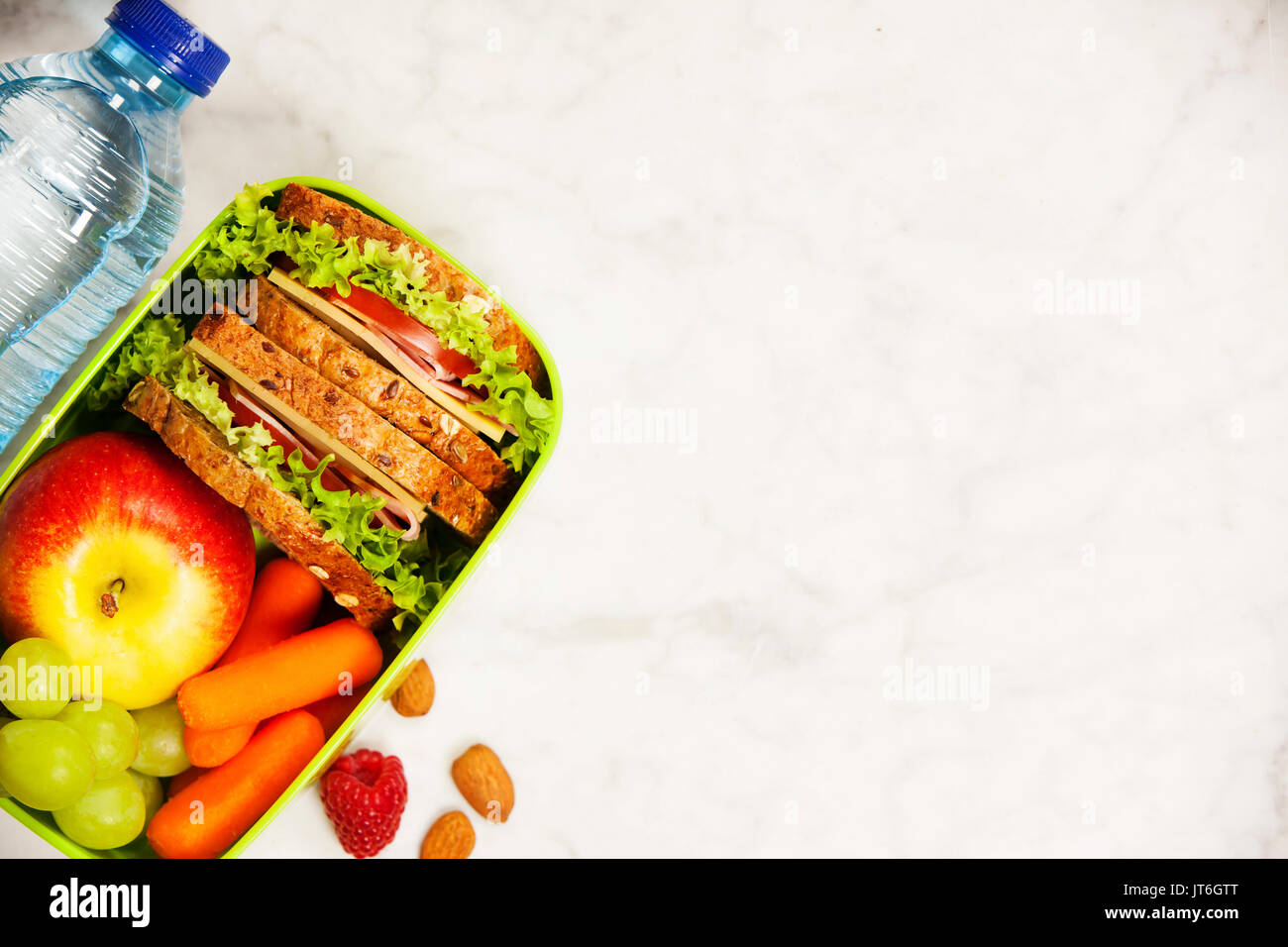 Healthy School Lunch Box With Sandwich Apple Grape Carrot And Stock Photo Alamy