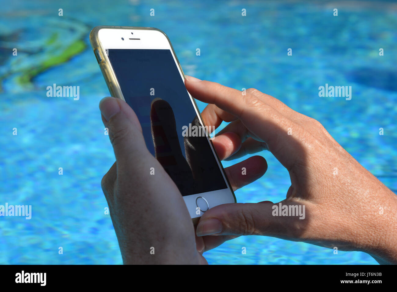 Digital technology. Using mobile device on holiday. - Stock Image