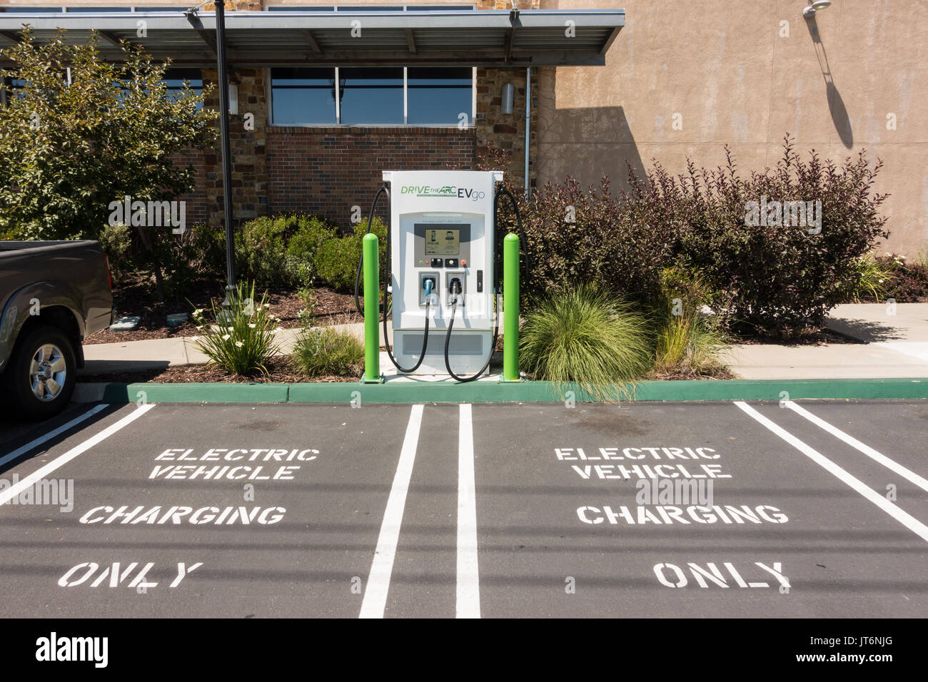 EV Electric Vehicle Charging Stations and parking spots at the front of the Whole Foods Market in Roseville, California - Stock Image