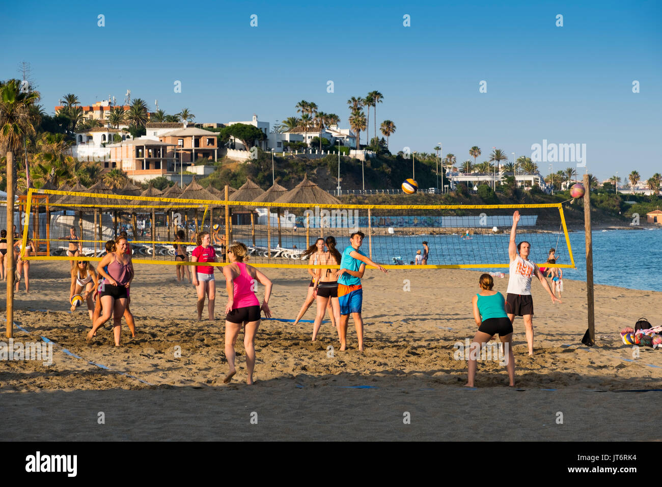 Playing volleyball at the beach, La Cala de Mijas. Costa del Sol, Málaga province. Andalusia, Southern Spain Europe - Stock Image