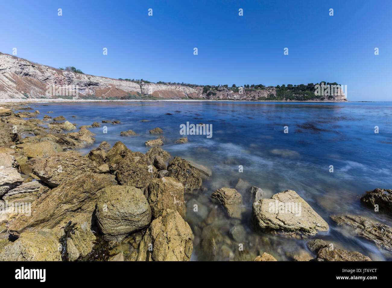 Lunada Bay with motion blur waves in the Palos Verdes Estates area of Los Angeles County, California. - Stock Image