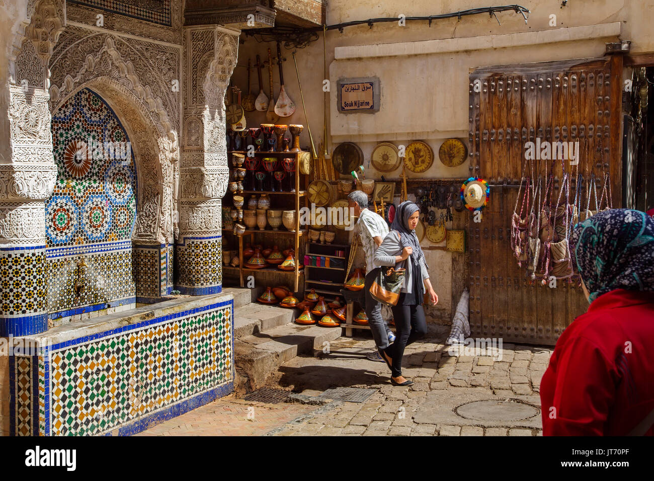 Nejjarine Fountain, Ceramic craft shop. Souk Medina of Fez, Fes el Bali. Morocco, Maghreb North Africa - Stock Image