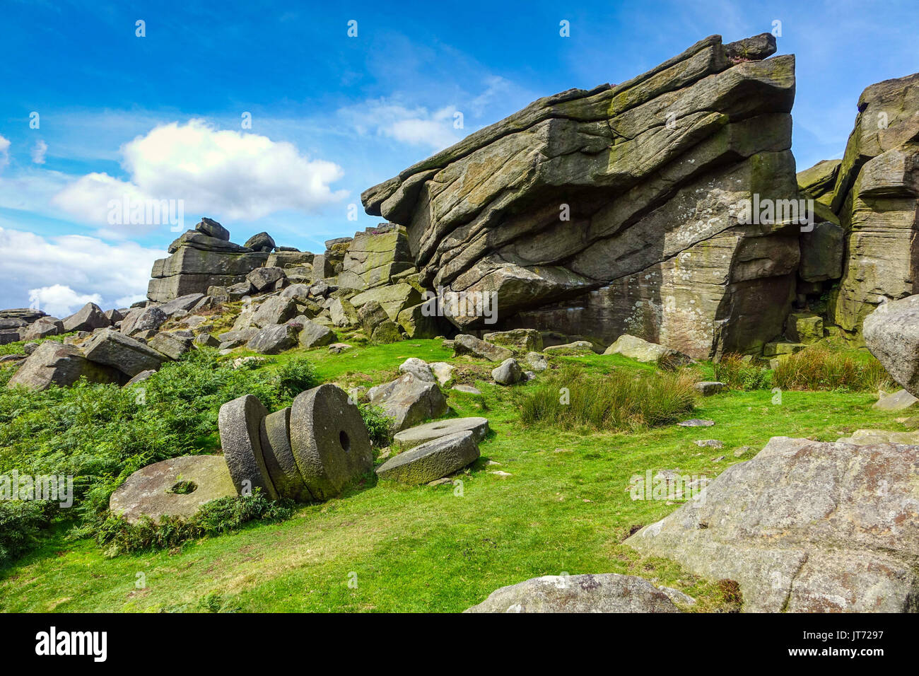 Abandoned millstones, below Stanage Edge, Peak District, Derbyshire - Stock Image