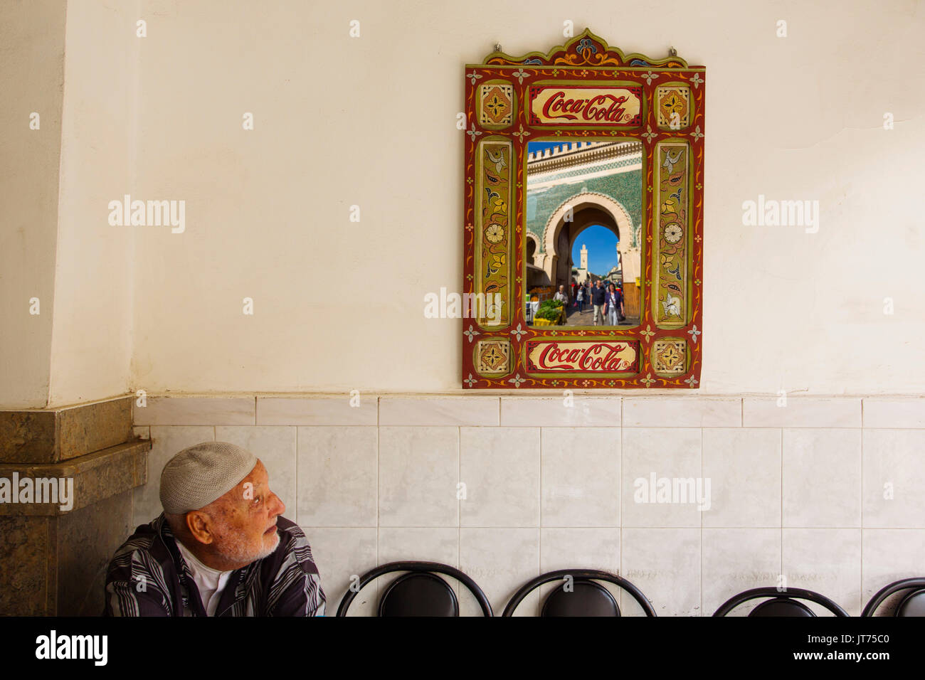 Street life scene. Bab Bou Jeloud gate reflected in a mirror, main entrance to Souk Medina of Fez, Fes el Bali. Morocco, Maghreb North Africa - Stock Image
