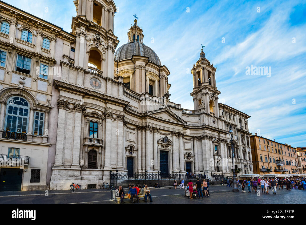 The exterior facade of the baroque Sant'Agnese in Agone cathedral in the Piazza Navona in Rome Italy on a sunny morning in late summer - Stock Image