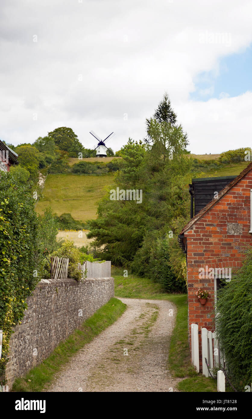 View along a country lane towards Cobstone Windmill  as used in the film Chitty Chitty Bang Bang, in the village of Turville in the Chiltern hills - Stock Image