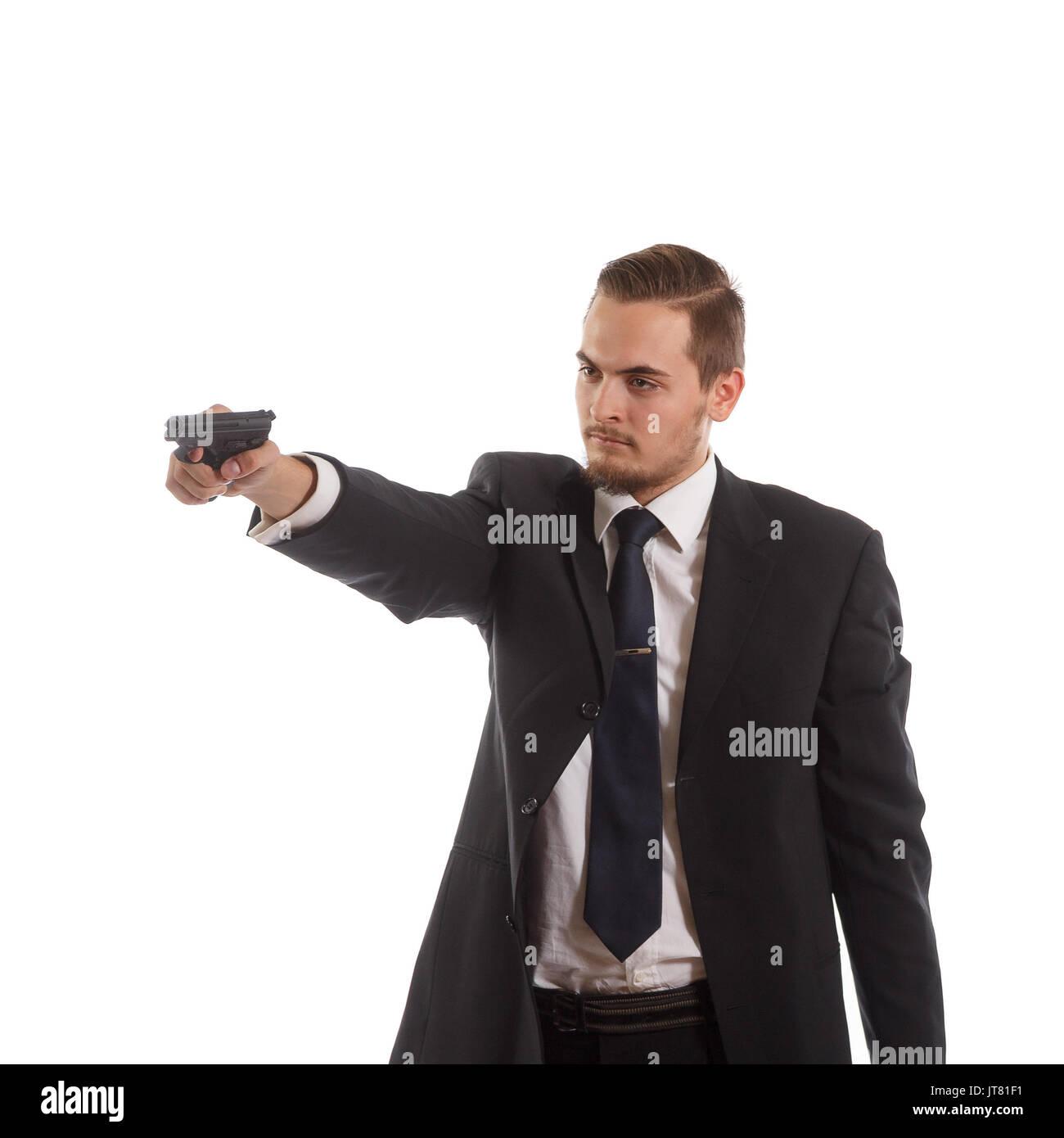 Man with a handgun - Stock Image
