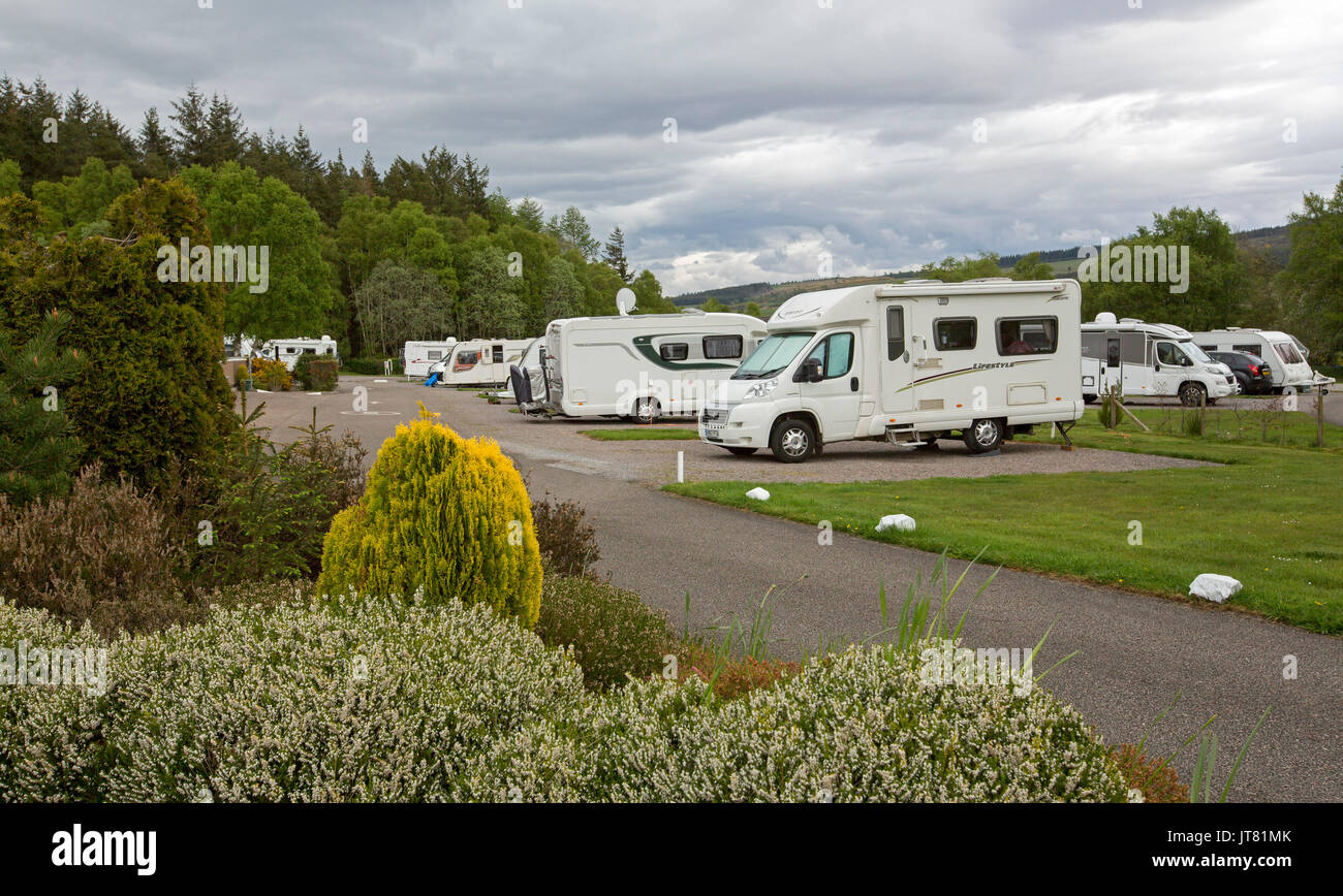 Motorhomes and caravans among manicured lawns and gardens at caravan park, Scotland - Stock Image