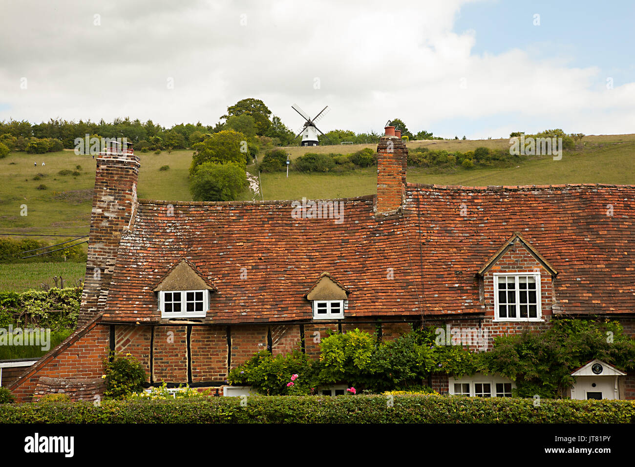 Turville in the English Chiltern hills with a view over country cottages towards Cobstone windmill the setting for Chitty Chitty Bang Bang - Stock Image