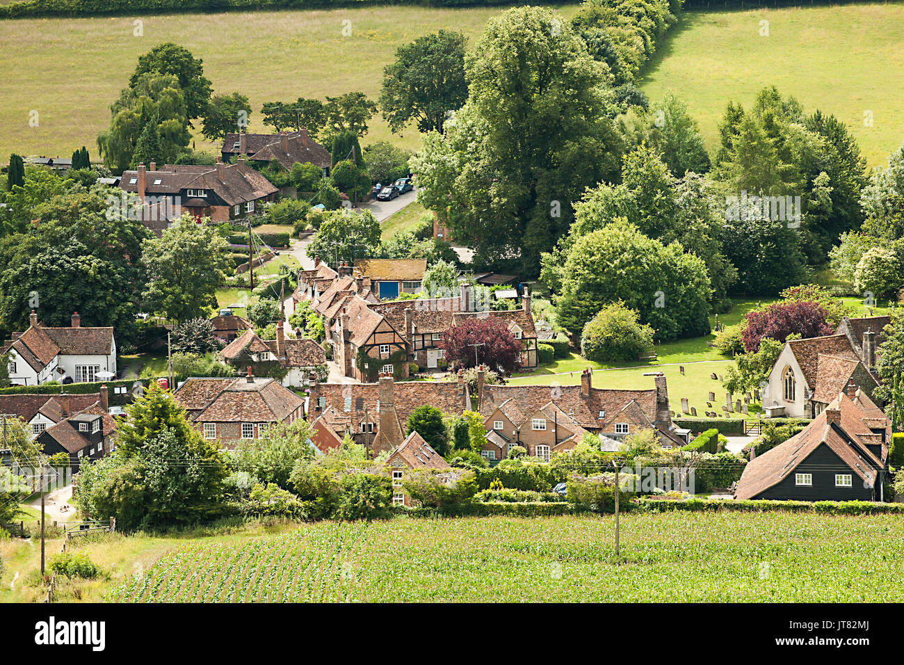 View over  the village of Turville in the English Chiltern hills  with  country cottages and St Mary's parish church  setting for the Vicar of Dibley - Stock Image