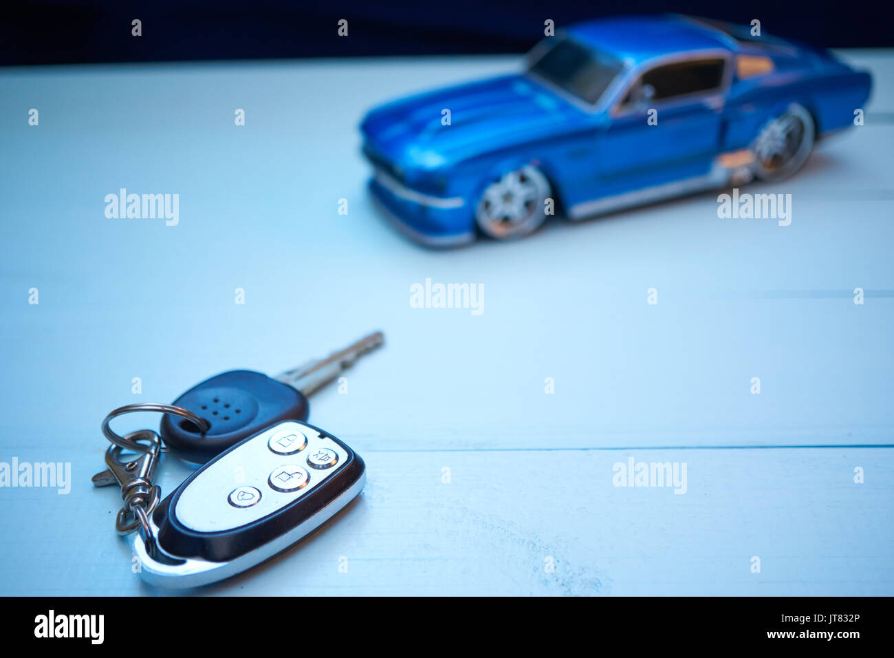 Car Keys On A Desk With Toy Car Blurred On Background Car Rental Stock Photo Alamy