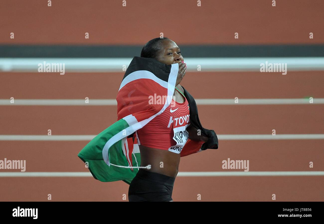 London, UK. 7th Aug, 2017. Faith Chepngetich KIPYEGON (KEN) celebrates with the Kenyan flag following her win in Stock Photo