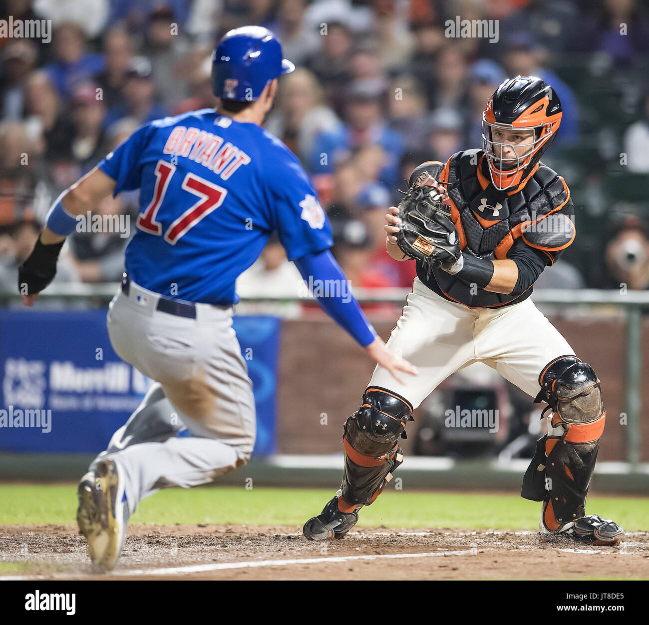 San Francisco, California, USA. 07th Aug, 2017. August 07, 2017: Chicago Cubs third baseman Kris Bryant (17) tagged out at home plate by Giants catcher Buster Posey (28) in the seventh inning, during a MLB game between the Chicago Cubs and the San Francisco Giants at AT&T Park in San Francisco, California. Valerie Shoaps/CSM Credit: Cal Sport Media/Alamy Live News - Stock Image