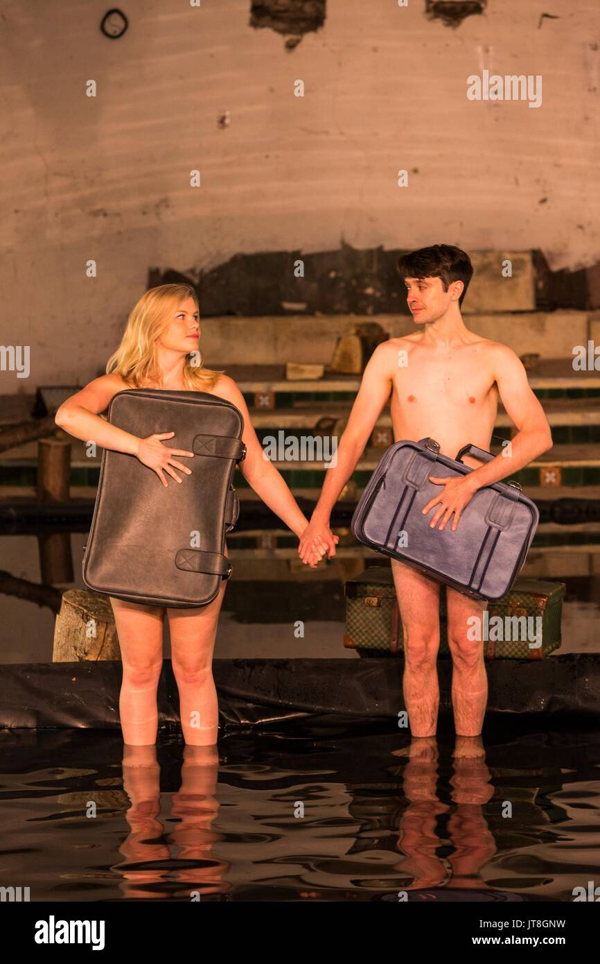 Edinburgh, Scotland, UK. 08th Aug, 2017. Performers from Volcano Theatre's Seagulls perform partly submerged in 45 tonnes of water in an interior lake filling St James church in Leith.  Seagulls is an adaption of Chekov's The Seagull. Credit: Rich Dyson/Alamy Live News - Stock Image