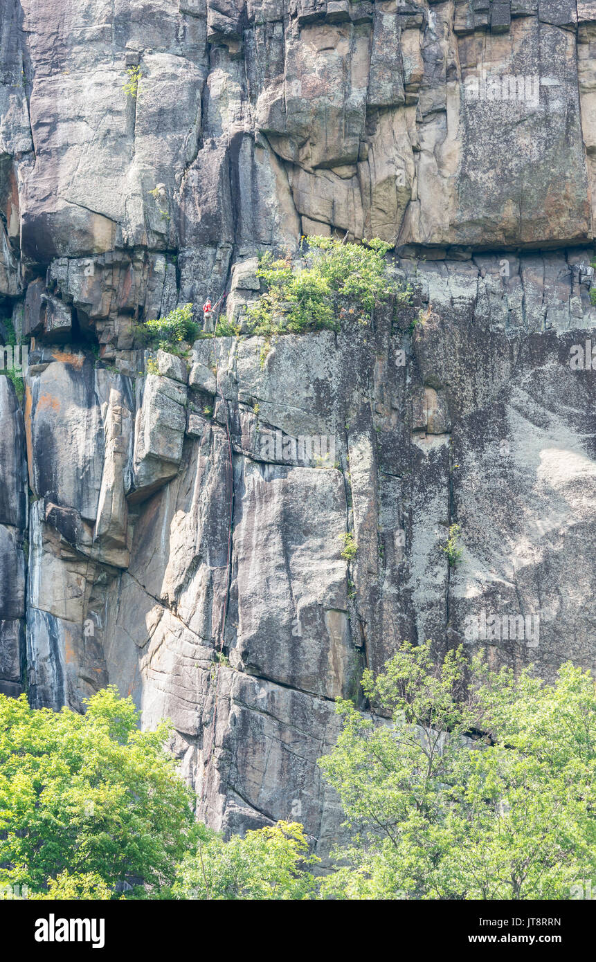 Rock climbers scaling the cliffs of Poke-O-Moonshine mountain New York - Stock Image