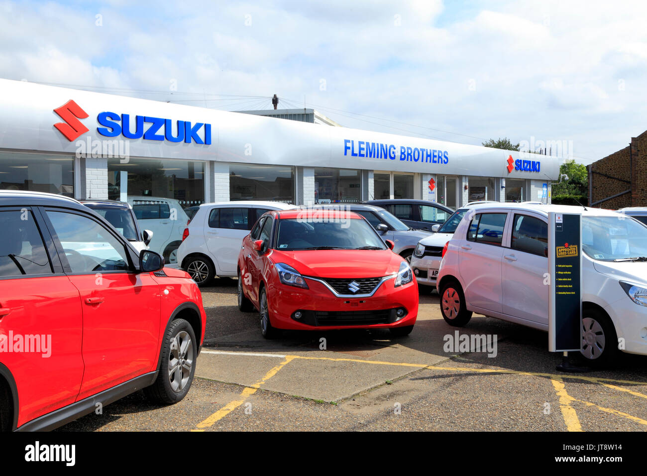 Suzuki car dealers, main dealership, dealer, dealerships, Fleming Brothers, showroom, showrooms, Hunstanton, Norfolk, England, UK, cars, vehicles - Stock Image