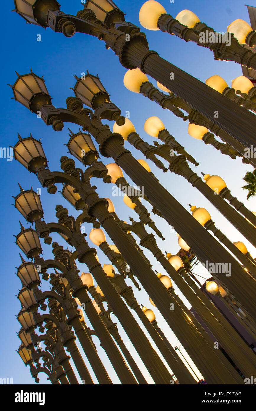 Urban Light is a large-scale assemblage sculpture by Chris Burden located at the Wilshire Boulevard entrance to the Los Angeles County Museum of Art. - Stock Image