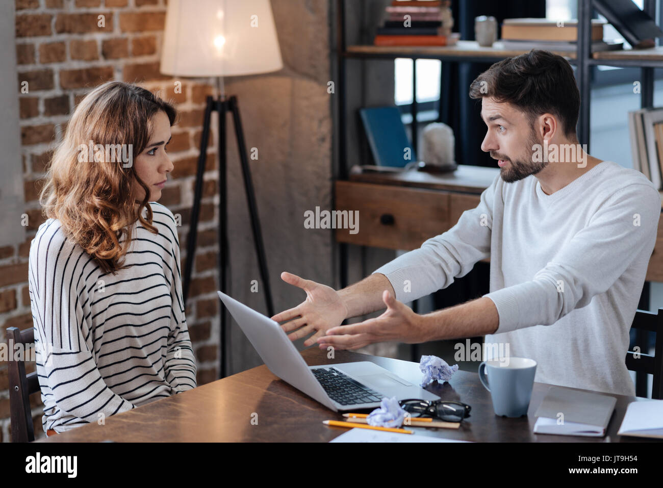 Unhappy angry man pointing at the laptop - Stock Image