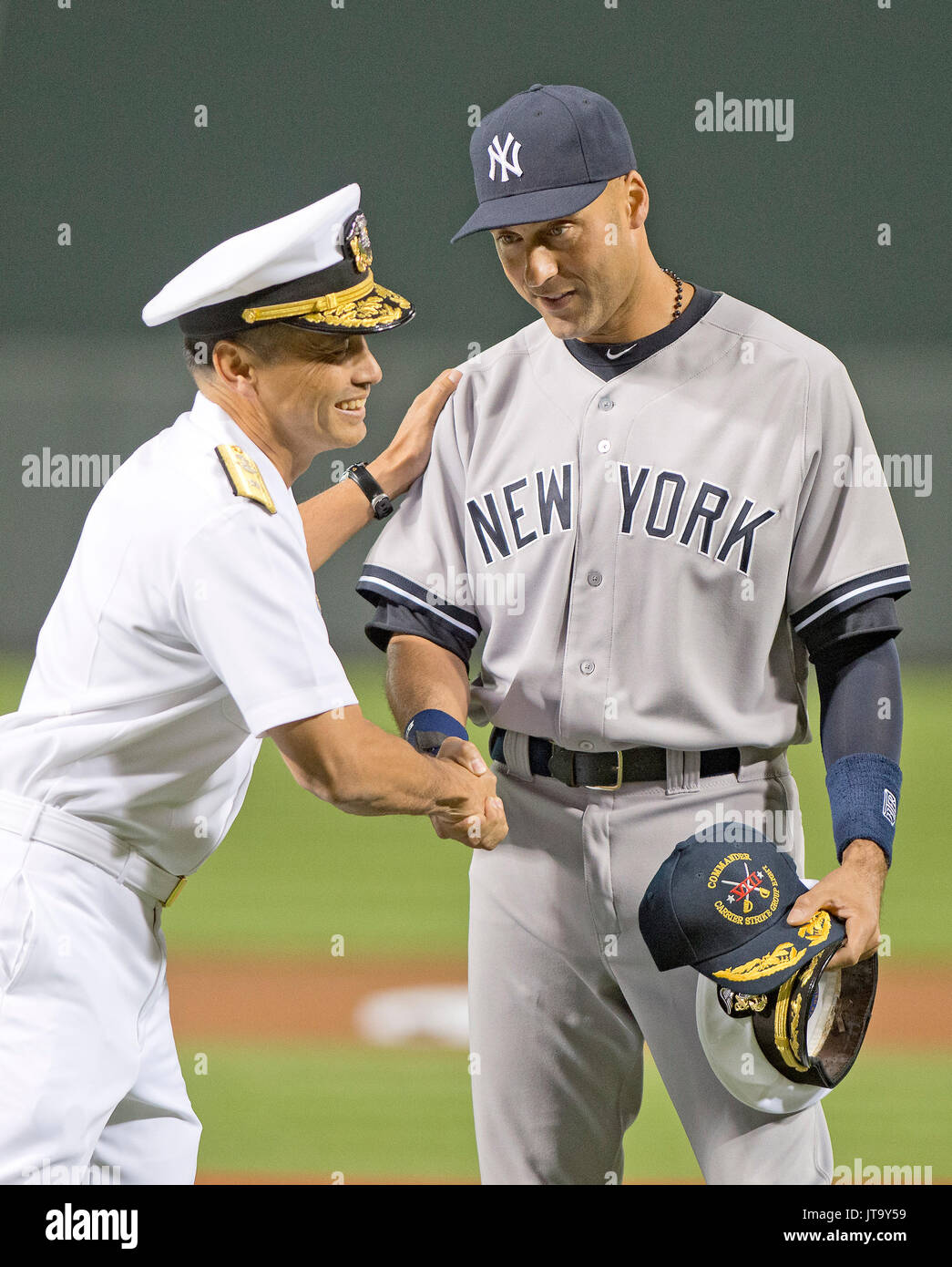 bb8e9373f41 New York Yankees shortstop Derek Jeter (2) is presented a Captain s Hat by  Rear