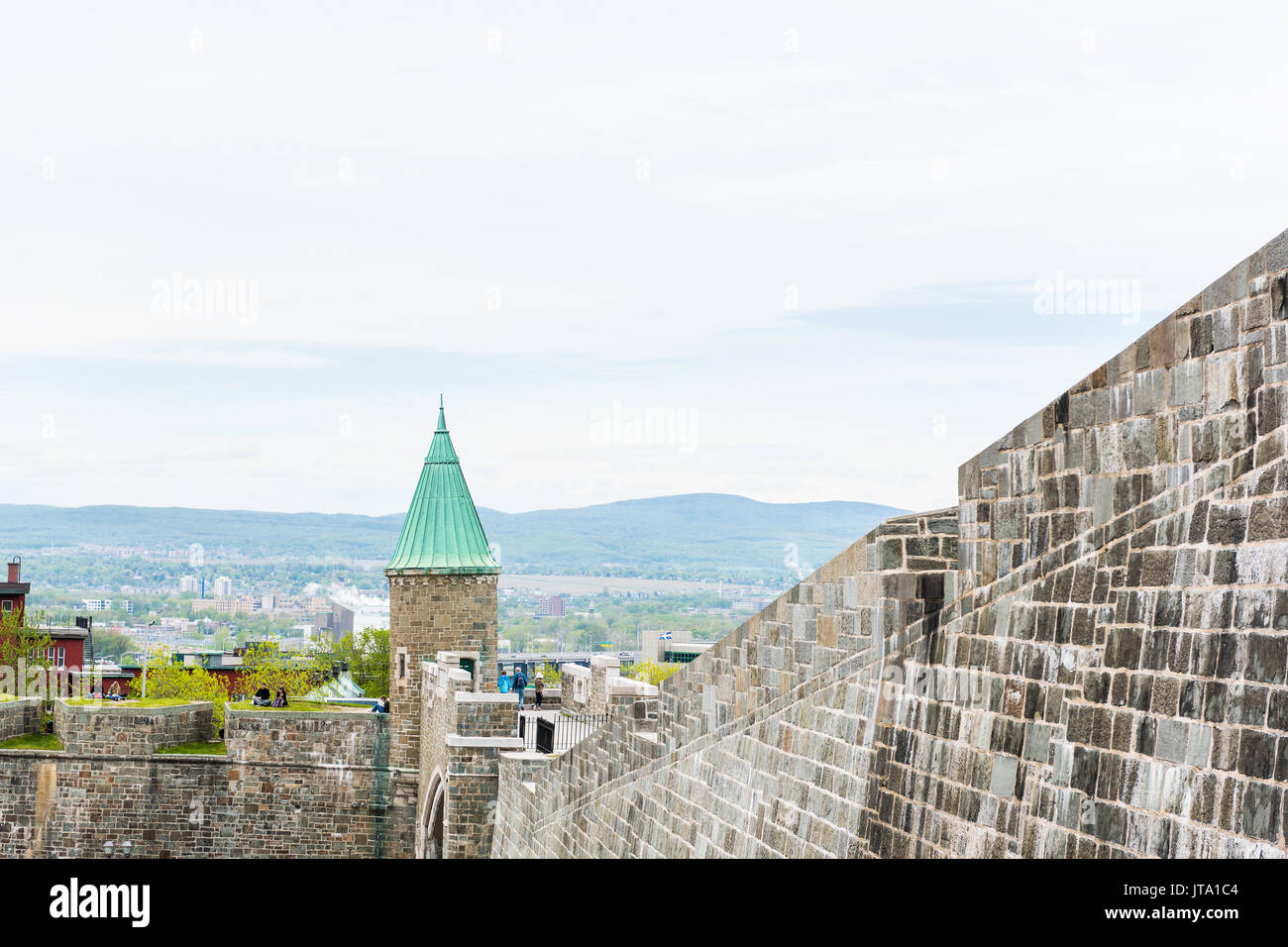 Quebec City, Canada - May 29, 2017: Fortifications stone wall and cityscape or skyline view - Stock Image