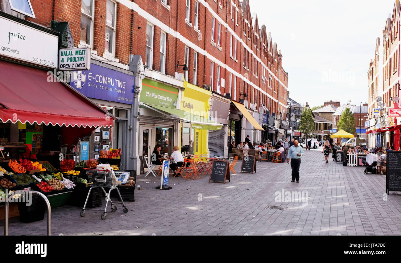London UK - Pavement cafes and shops just off Balham High Road South London - Stock Image