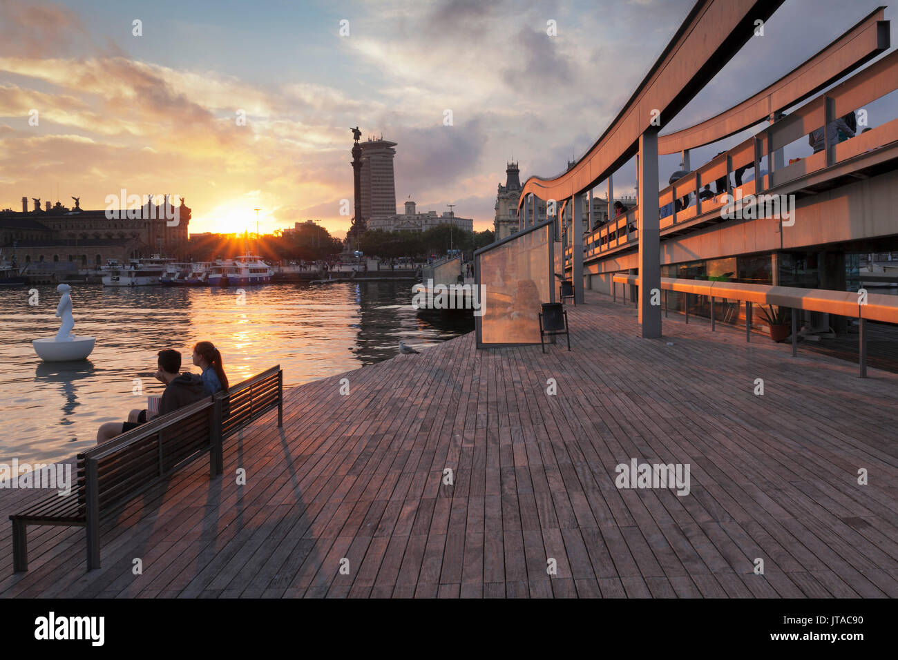 Rambla del Mar at Port Vell, Edificio Colon Tower and Columbus Monument (Monument a Colom), Barcelona, Catalonia, Spain, Europe - Stock Image