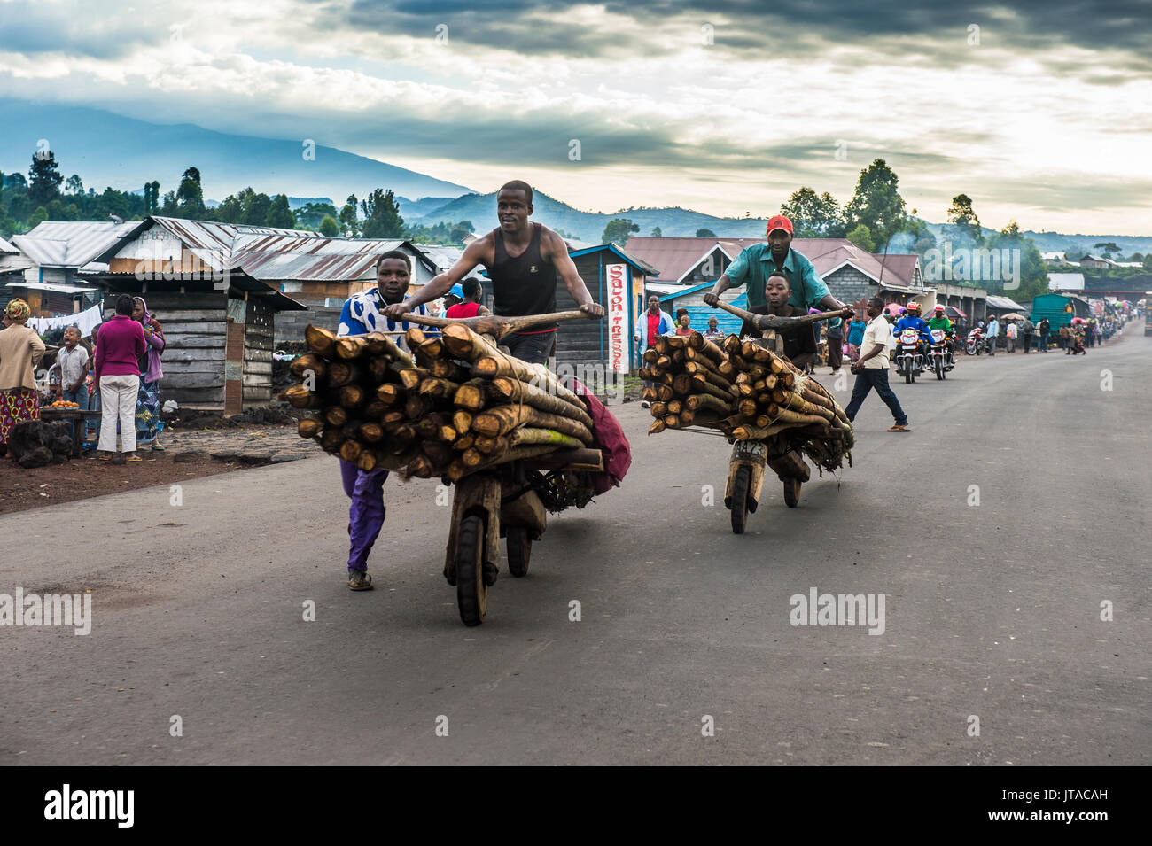 Local men transporting their goods on self made carriers, Goma, Democratic Republic of the Congo, Africa - Stock Image