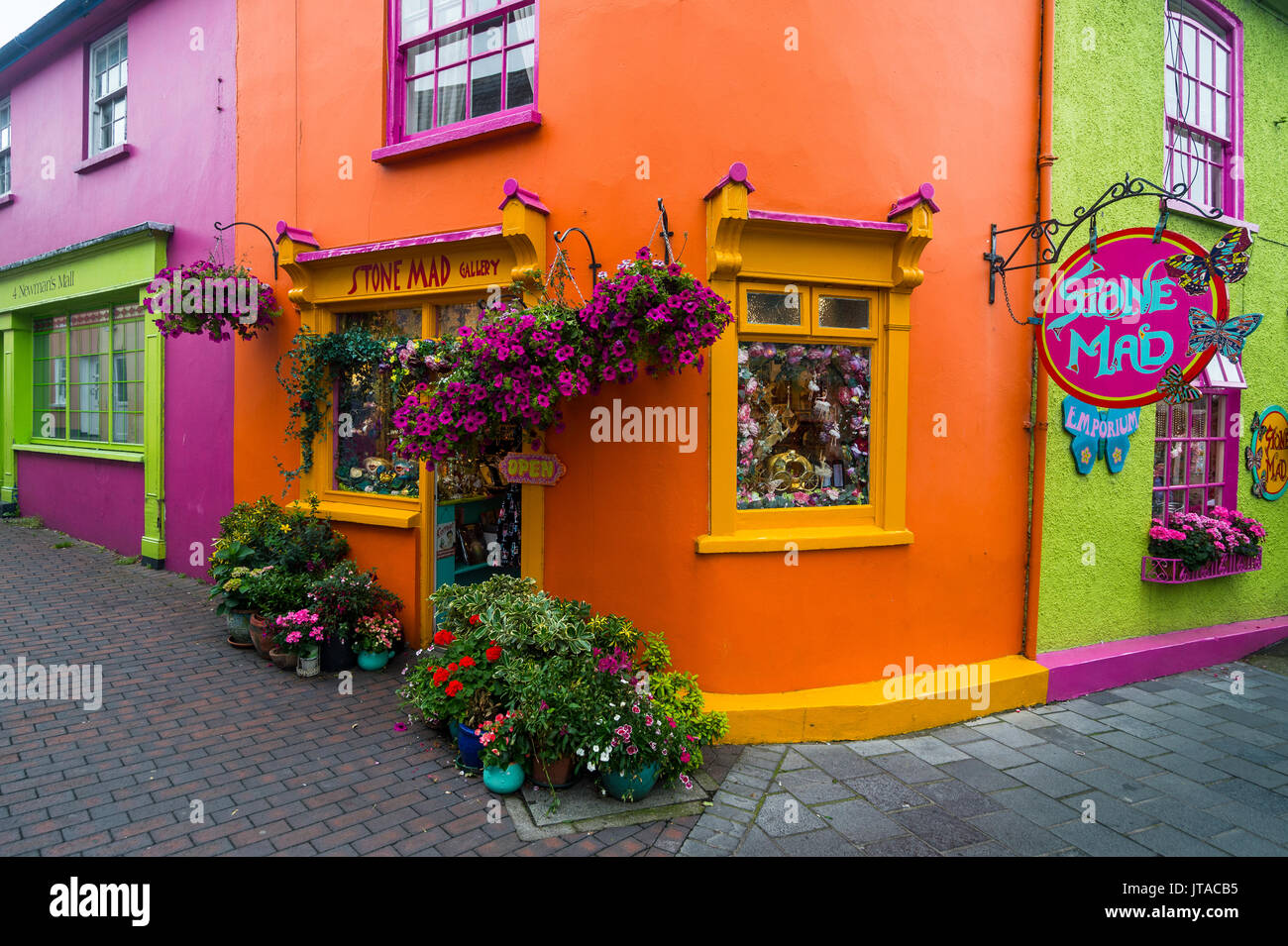 Brightly coloured shops in Kinsale, County Cork, Munster, Republic of Ireland, Europe Stock Photo