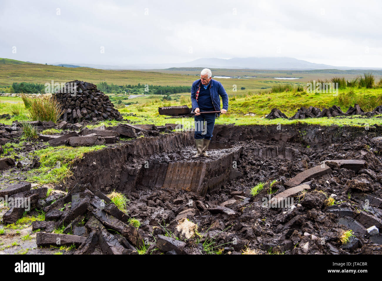 Blocks of peat cut out on a traditional farm, Connemara National Park, County Galway, Connacht, Republic of Ireland, Europe - Stock Image