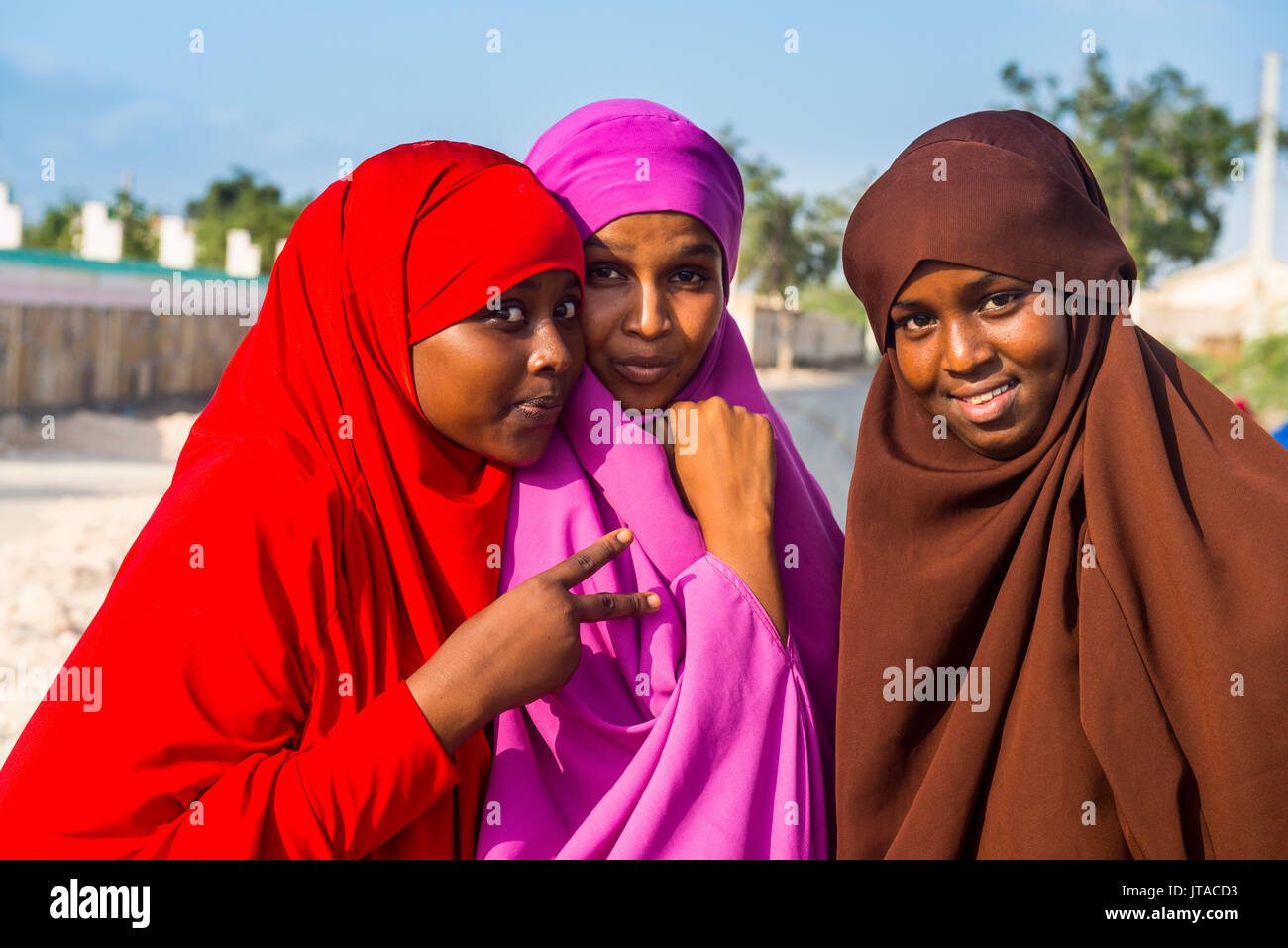 Colourfully dressed Muslim women in the coastal town of Berbera, Somaliland, Somalia, Africa - Stock Image