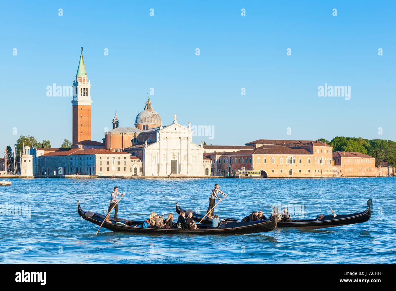 Venetian gondolas with tourists opposite the Island of San Giorgio Maggiore, Canale di San Marco, Venice, UNESCO, Veneto, Italy - Stock Image