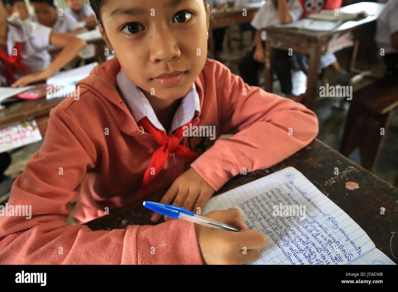 Laotian schoolgirl, Elementary School, Vieng Vang, Laos, Indochina, Southeast Asia, Asia - Stock Image