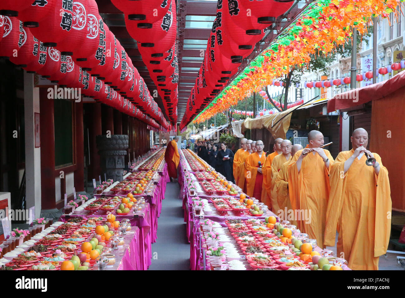 Ullambana ceremony, when food is offered to the ancestors during the annual Ghost Festival, Buddha Tooth Relic Temple, Singapore - Stock Image