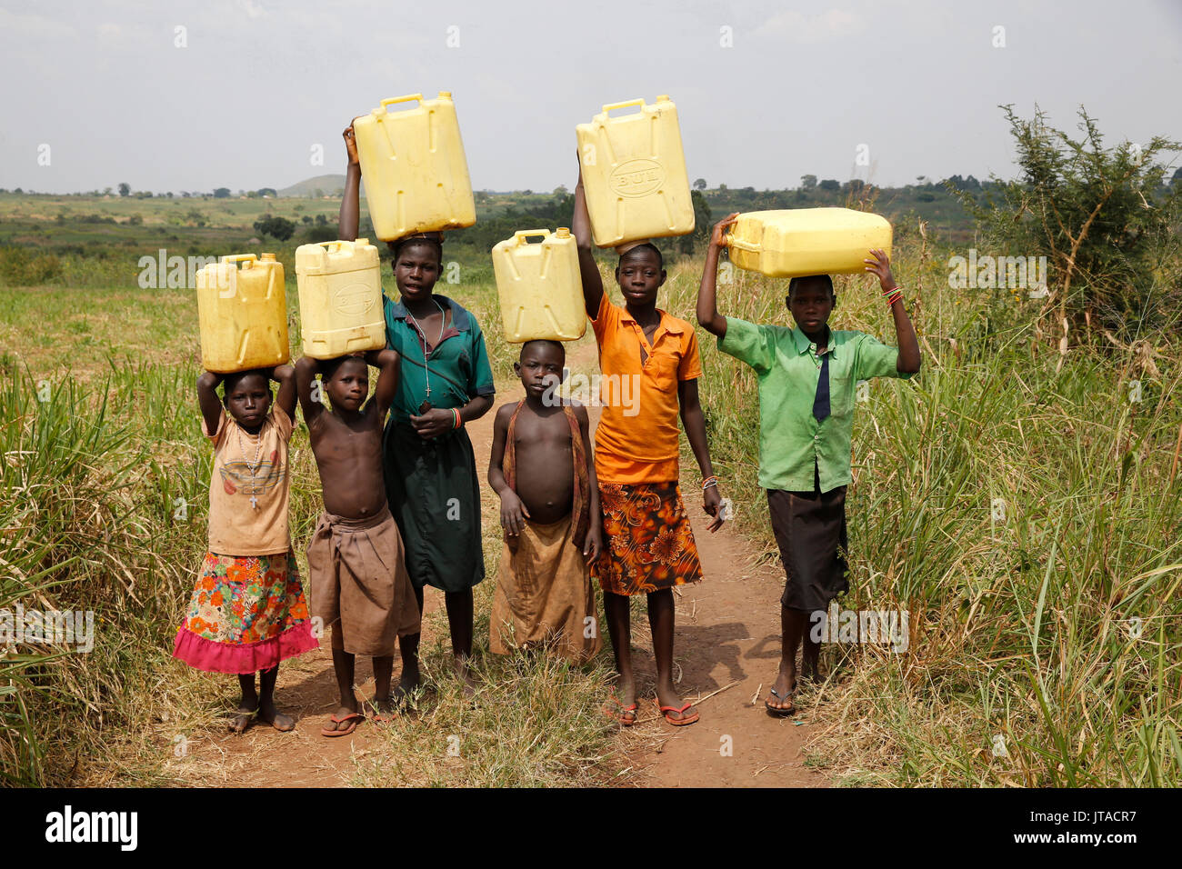 Ugandan children fetching water, Masindi, Uganda, Africa - Stock Image